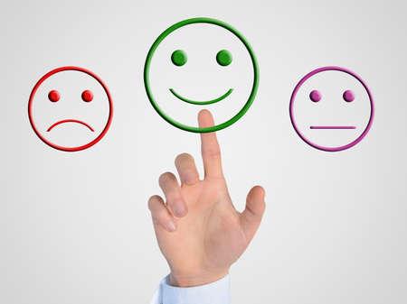 cara sonriente: La mano del hombre de prensa botón cara feliz