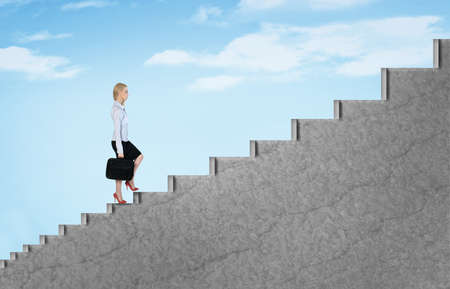 Young business woman climb stairs to sky