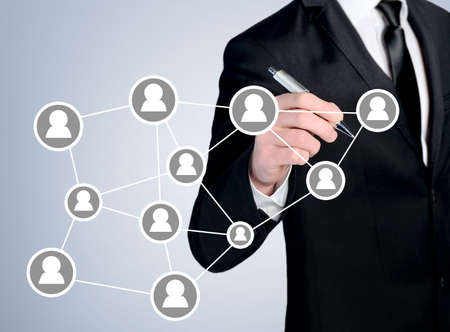 red de personas: Business man close-up write people network Foto de archivo