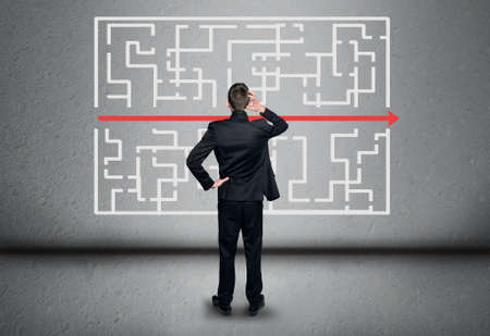 solved maze puzzle: Maze and business man thinking solution Stock Photo