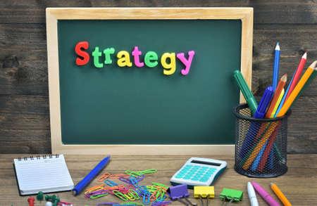 school strategy: Strategy word on school board Stock Photo