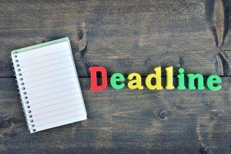 deadline: Deadline word on wooden table