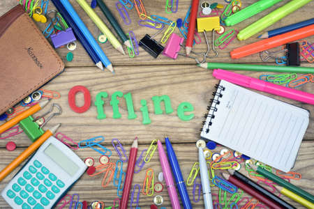 offline: Offline word and office tools on wooden table Stock Photo