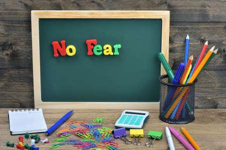 no fear: No fear word on school board Stock Photo