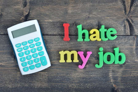 dismiss: I hate my job word on wooden table