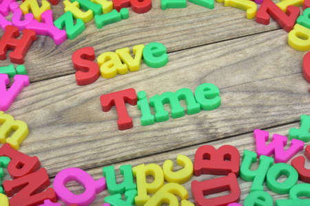 save time: Save Time word on wooden table