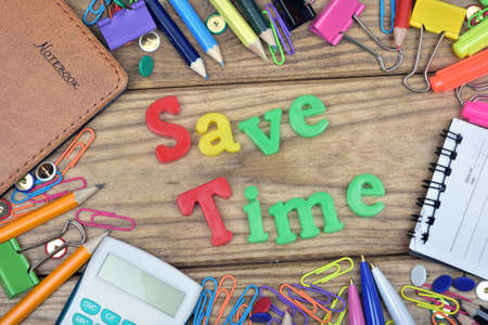 save time: Save Time word and office tools on wooden table