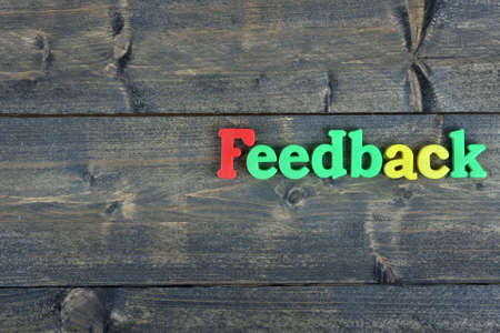 suggestions: Feedback word on wooden table