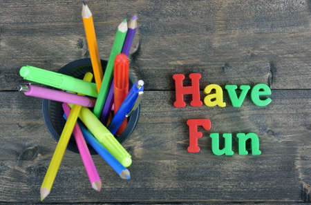 have on: Have fun word on wooden table Stock Photo