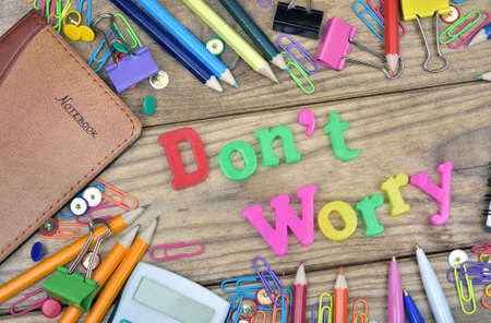 dont worry: Dont Worry word and office tools on wooden table