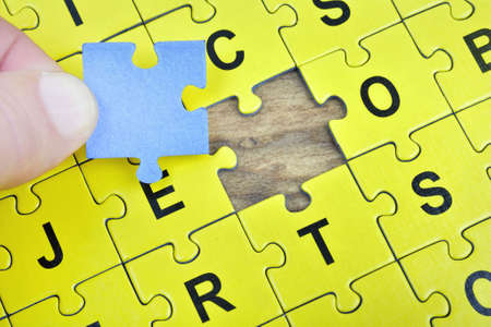 complete solution: Puzzle pieces on wooden table Stock Photo
