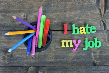 hate: I hate my job word on wooden table