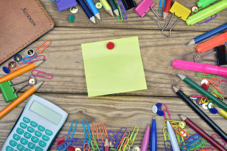 postit: Post-it and office tools on wooden table