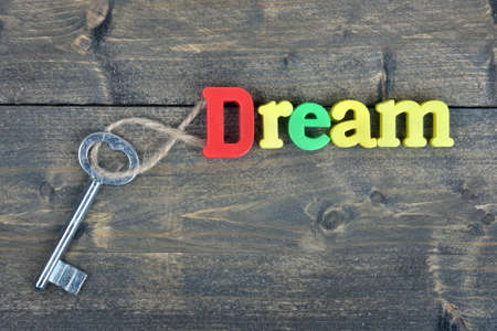 antique sleigh: Dream word on wooden table Stock Photo