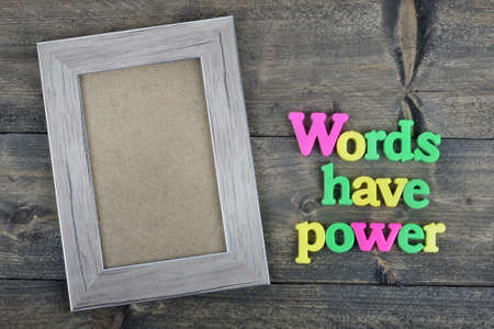 to have: Words have power word on wooden table Stock Photo