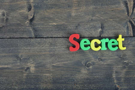 undercover: Secret  word on wooden table
