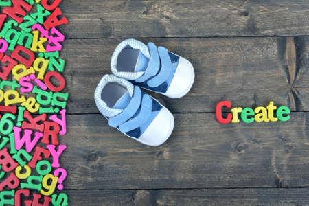 create: Create word on wooden table