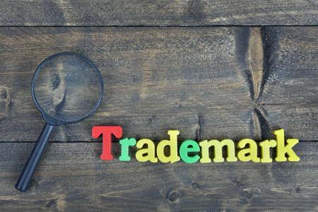 trademark: Trademark word on wooden table