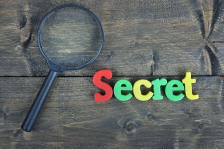 undisclosed: Secret  word on wooden table