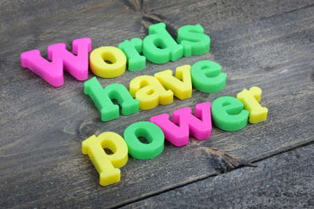 Words have power word on wooden table 版權商用圖片