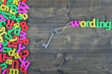 keywording: Keywording word on wooden table Stock Photo