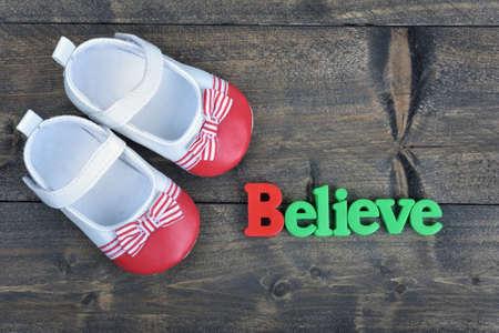 believe: Believe word on wooden table