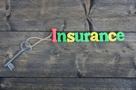 antique sleigh: Insurance word on wooden table