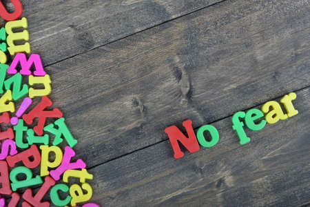 no fear: No fear word on wooden table Stock Photo