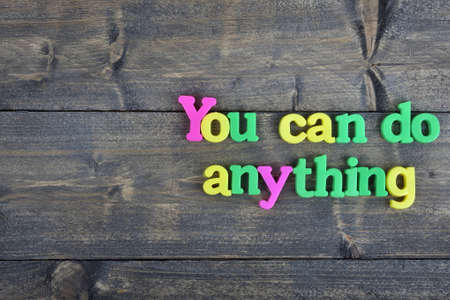 anything: You can do anything word on wooden table