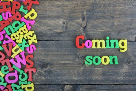 anticipated: Coming Soon word on wooden table
