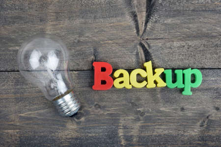 power concept: Backup word on wooden table