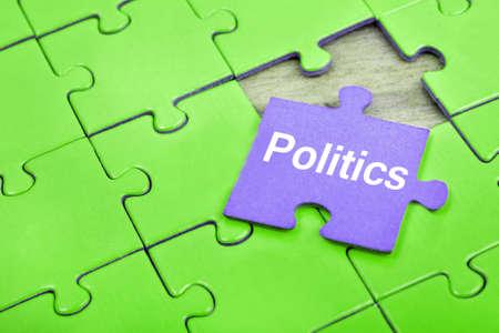 paciencia: Pedazos del rompecabezas con la palabra Política Foto de archivo