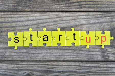 Puzzle pieces with word Startup Stock Photo