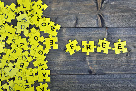complete solution: Puzzle pieces with word Free