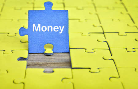 playing the market: Puzzle pieces with word Money