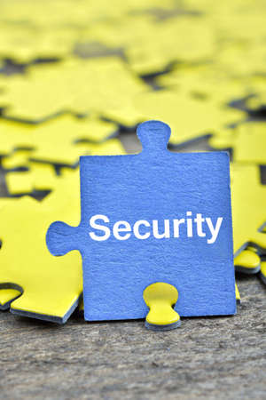 Puzzle pieces with word Security Stock Photo
