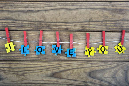 romance strategies: Puzzle pieces with word I love you Stock Photo