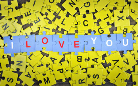 love strategy: Puzzle pieces with word I love you Stock Photo