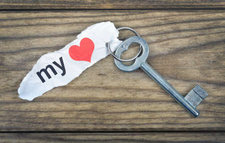 door lock love: Key with message my Love on wooden table Stock Photo