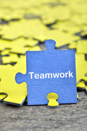 Puzzle pieces with word Teamwork Stock Photo
