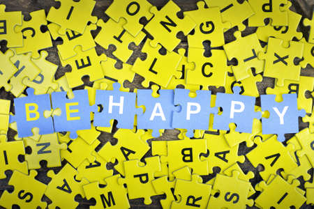 be missing: Puzzle pieces with word Be happy