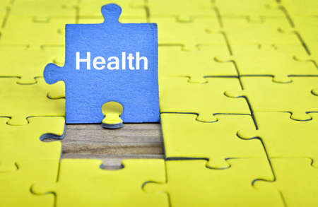 complete solution: Puzzle pieces with word Health Stock Photo