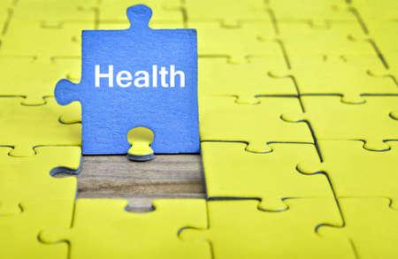Puzzle pieces with word Health Banco de Imagens