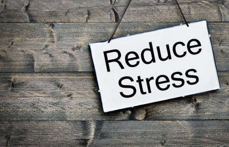 reduce: Reduce Stress message on wooden table
