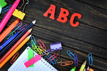 office tools: ABC and office tools on wooden table