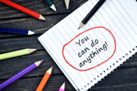 anything: You can do anything text on notepad and colorful pencils Stock Photo