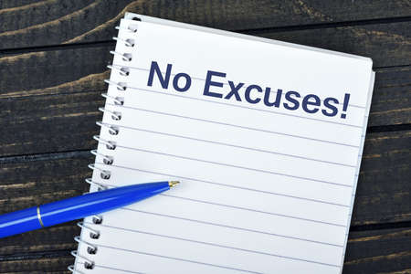 excuse: No Excuses text on notepad and blue pen Stock Photo