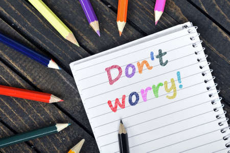 dont worry: Dont Worry text on notepad and colorful pencils