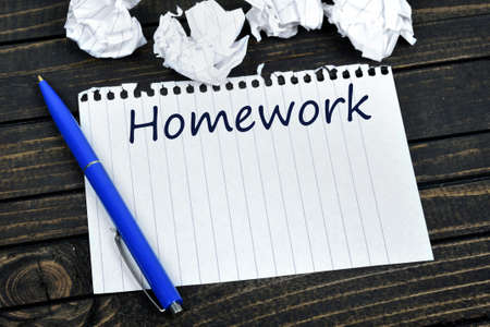 unmotivated: Homework text on notepad and crippled paper Stock Photo