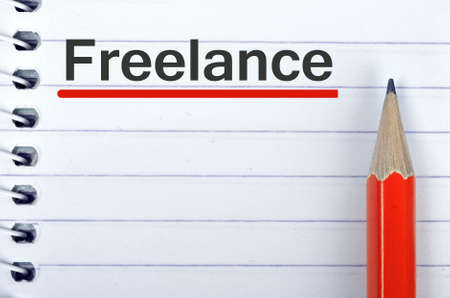 freelance: Freelance text on notepad and red pencil